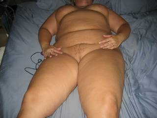 Mrs Daytonohfun looking worn out and well fucked after I finished fucking her for about 2 hours as her hubby watched.  She's laying there with a cum filled pussy and my creampie inside of her