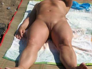 Wife exhibiting herself on beach