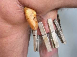My ass filled with a sweet potato,my cock sucked into a jar and some clothes pins clipped onto my ball sack !