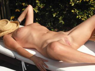 Sunbathing by the pool at home, love to feel the hot sun on my pussy