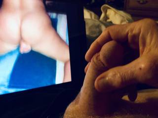 My penis is swollen and ready to spurt as I watch a video of my friend Candy fucking herself with a dildo..