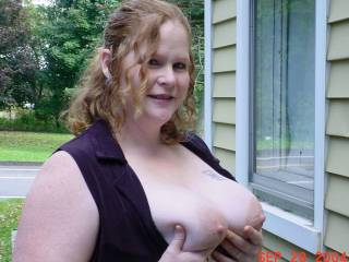 My wife out showing off her tits out in the yard.