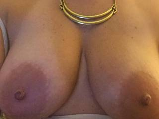 Absolutely the most perfect tits ever!!  And until I read your comment, I swear I did not even see her necklace...how could you?!?  Sweet perfection!!