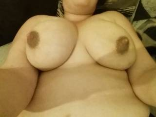 what a simply lovely picture! A beautiful woman indeed! Those lovely tits and nipples are definitely enough to be shared by hubby and I don't you think? (hehehe)