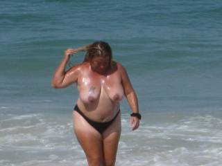 deb at the beach looking for some one to help her from getting a sun burn