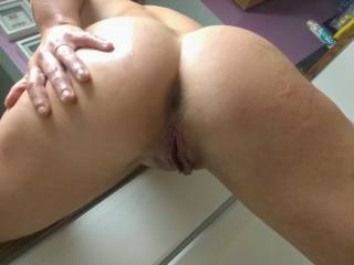 She was bent over wanting me to come  fuck her pussy and ass.